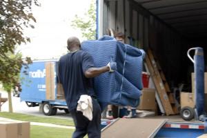An EE Ward employee loads a piece of furniture.