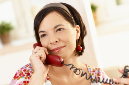 Young woman on the phone at home